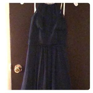 Knee length semi-formal bridesmaid dress.
